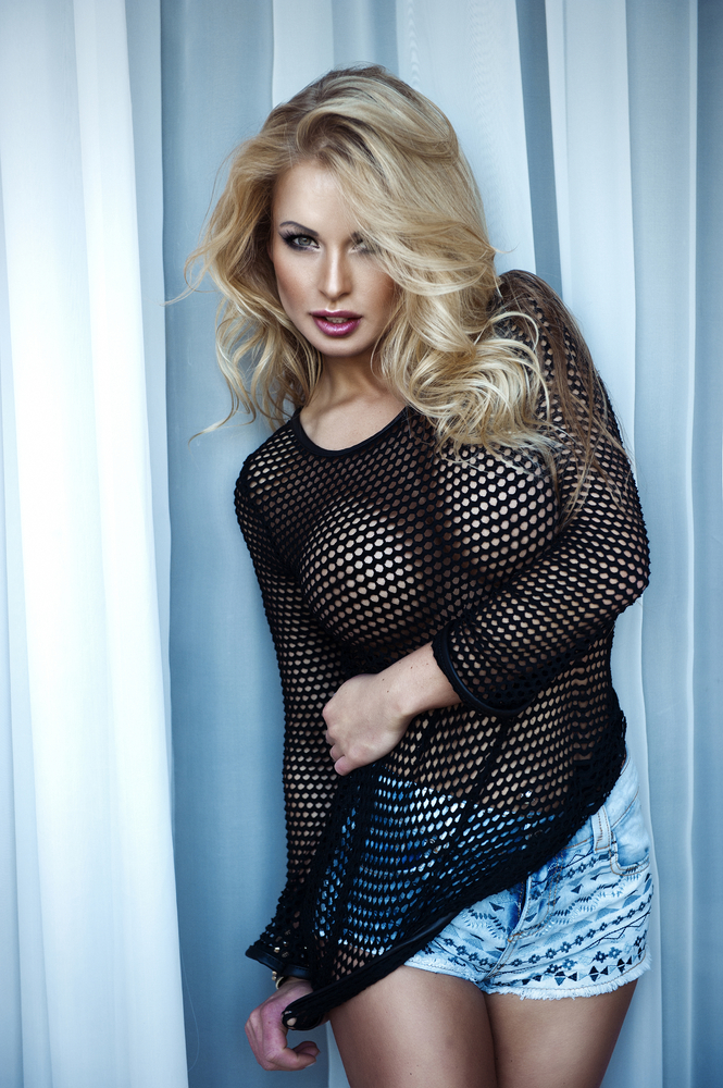 Carla showing off her huge boobs in a fishnet top