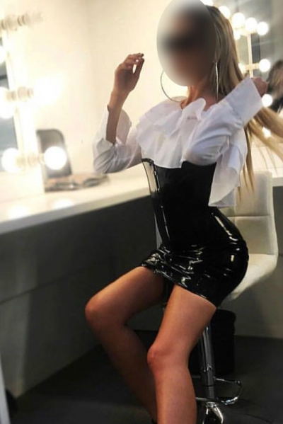 Beatrice looking hot in a white shirt and black latex skirt