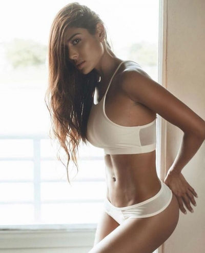 Ivana in white underwear showing off her toned figure