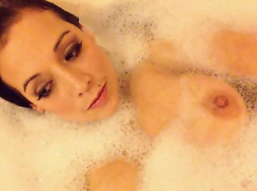 Alexis teasing as she shows her boobs whilst she takes a bath