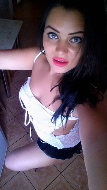 Selfie of Sindy wearing pretty white top with pink lipstick.