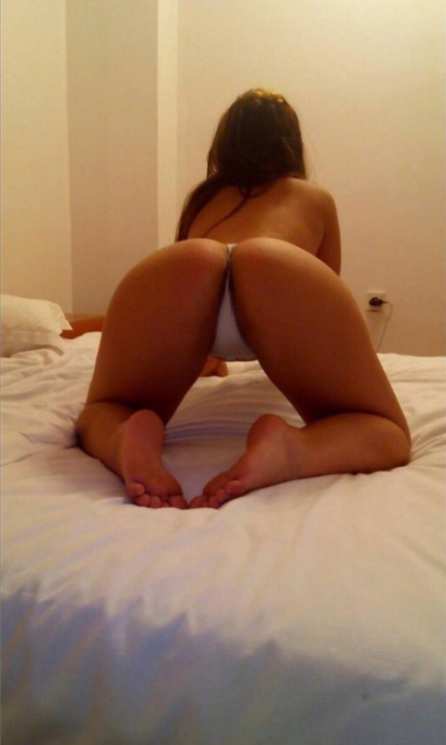 Backview of Sindy on all fours with no bra showing off big bum and white panties.