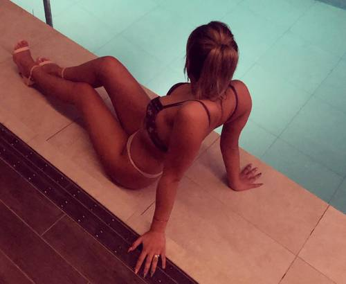 Yazmin lay next to a swimming pool in a sexy bikini